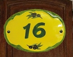 OVAL DOOR PLAQUE WITH GREEN NUMBER BACKGROUND YELLOW COLOR