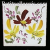 TILE WITH YELLOW AND RED FLOWERED DECORATION