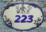 OVAL DOOR PLAQUE WITH BLUE NUMBER INSCRIPTION