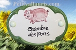 CERAMIC OVAL DOOR PLAQUE WITH PINK PIG DECOR
