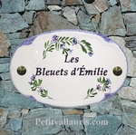 CERAMIC OVAL PLAQUE FORM WITH OLD PURPLE OR BLUE FLOWER COLO